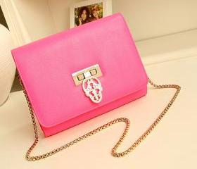 Candy-colored hollow skull evening bag
